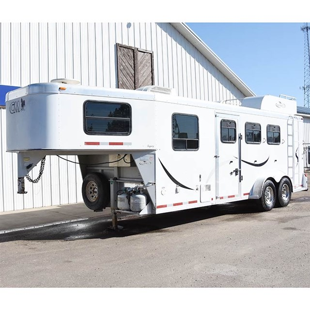 2003 Cm 3 horse trailer with 6' weekend package